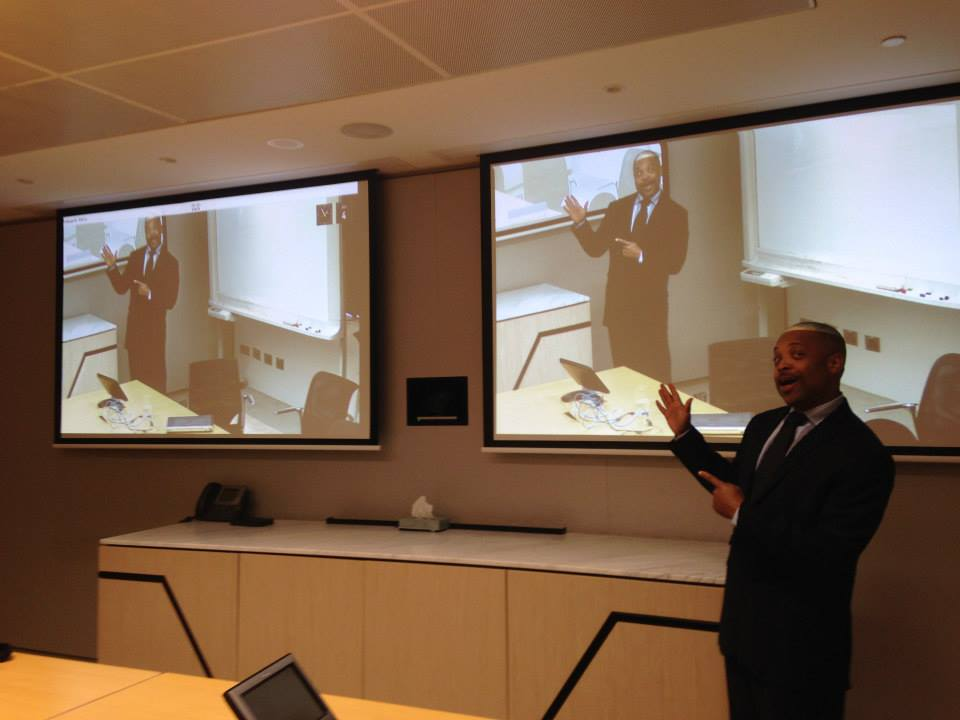 Jim Stroud meets with clients in Asia and around the world via telepresence.